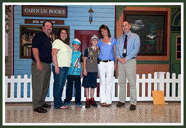 Brendan with proud parents Tom and Patricia, and Mikie with proud mom Sheri and O'Hara Principal Dr. Mike Rowe